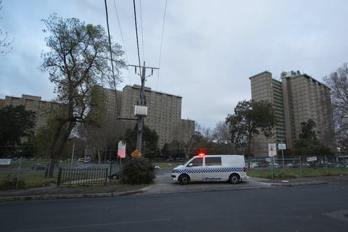 Police enforce the lockdown at public housing towers in Flemington.