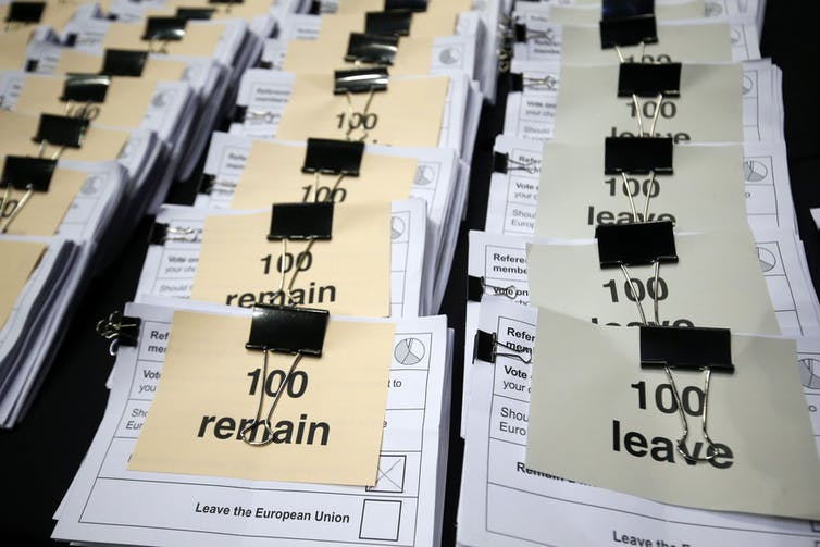 Stacks of paper votes marked Remain and Leave
