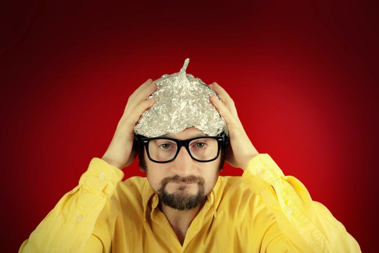 Conspiracy theorist stereotype in tinfoil hat.