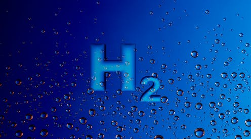 The chemical element 'H2' on a blue background with bubbles.