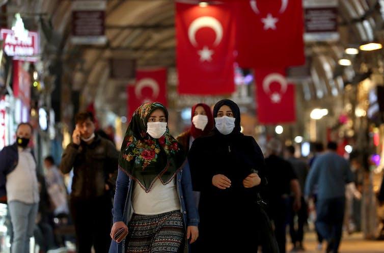 People wearing masks walking in the Grand Bazaar in Istanbul.