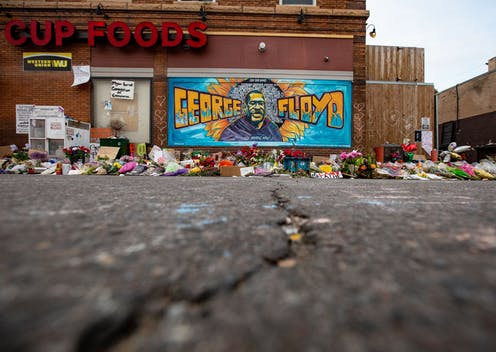 Flowers left at makeshift memorial for George Floyd in Minneapolis