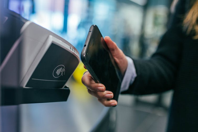 A phone being used to make a cashless payment