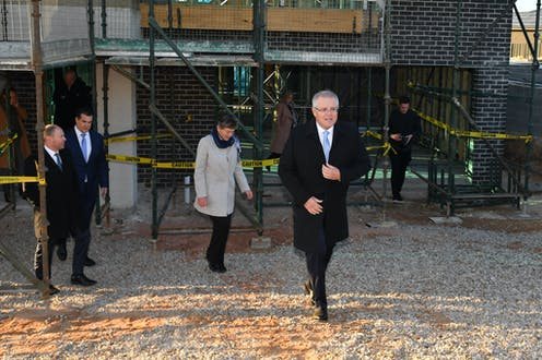 Prime Minister Scott Morrison arrives at a home construction site to announce the HomeBuilder scheme.