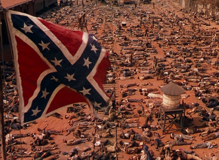 Confederate flag flies over the battlefield in Gone with the Wind.