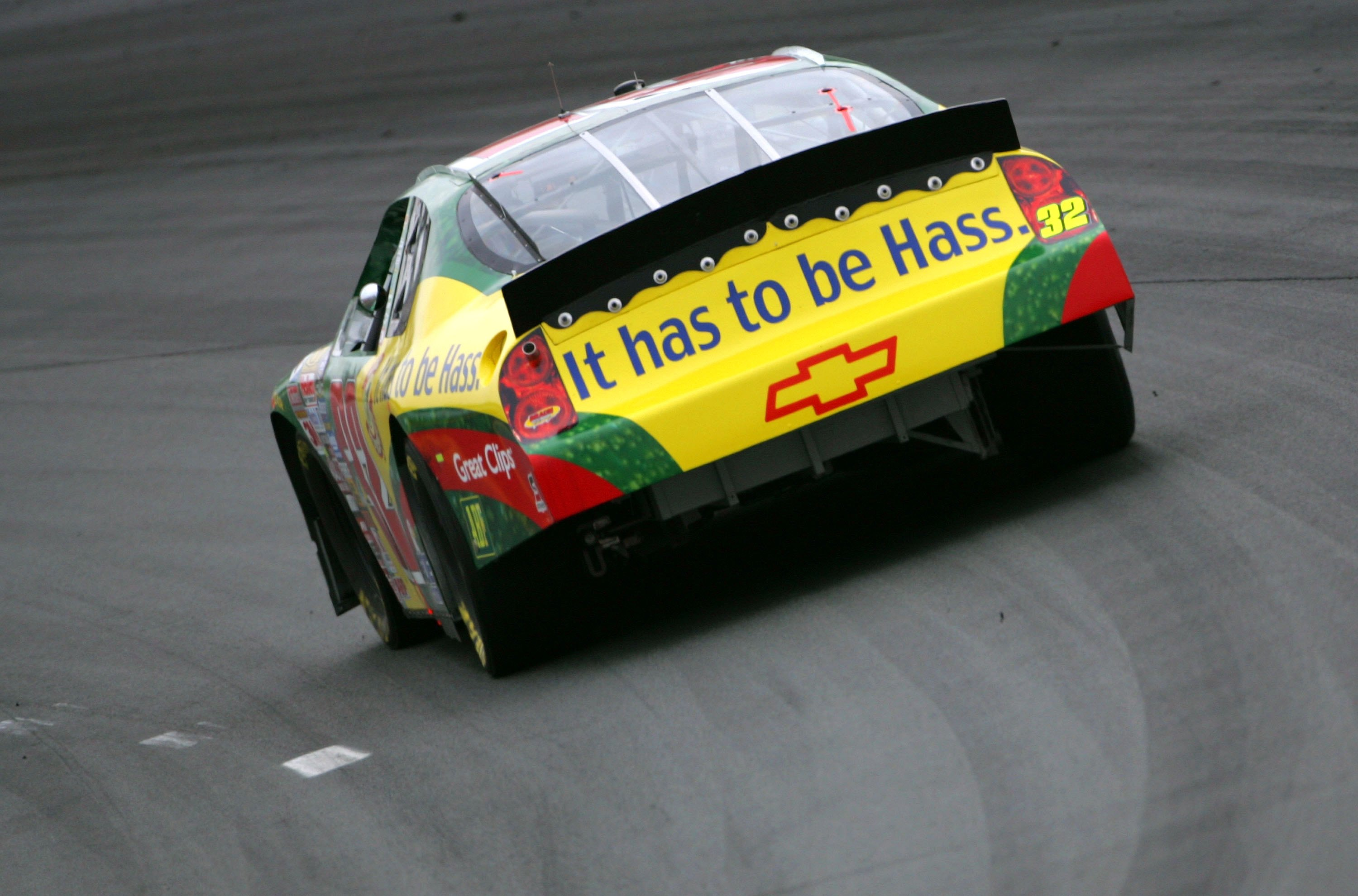 A racing car with an advertisement for the hate avocado.