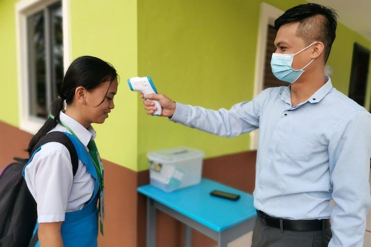 Will school temperature checks curb the spread of coronavirus?
