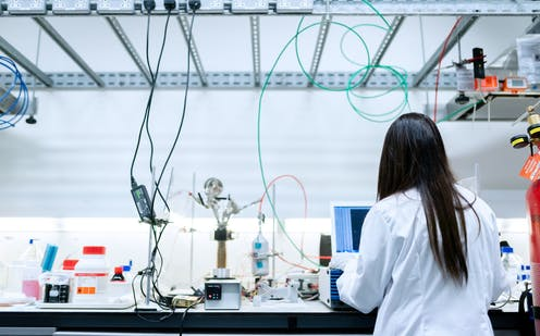 Female scientist working in an electronics lab