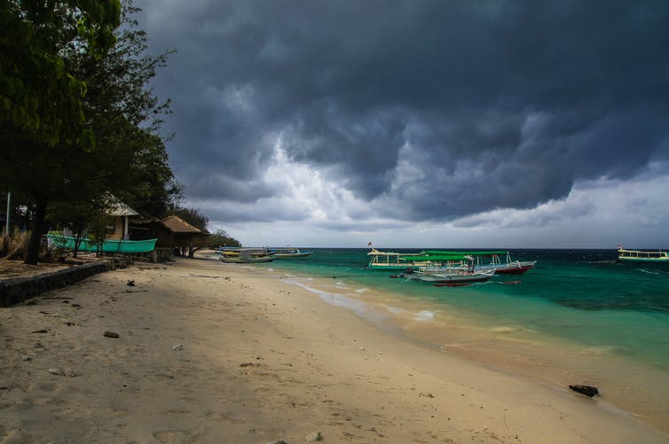 Thunderstorm clouds over tropical beach