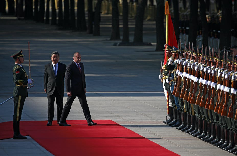 Xi Jinping and Rumen Radev next to row of Chinese soldiers