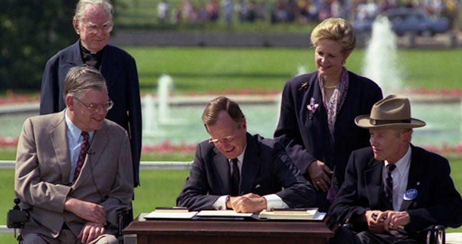 George H.W. Bush signs the ADA into law.