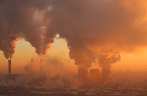 Pollution from a factory in dawn light.