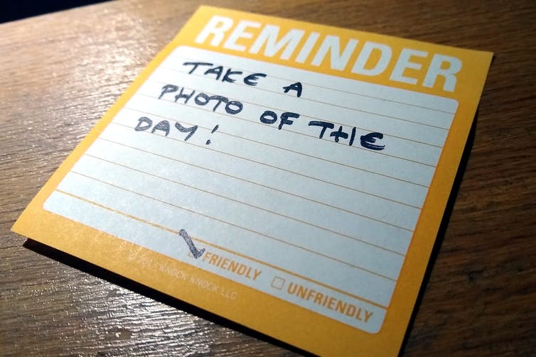 A written note to remind you to take a photo each day