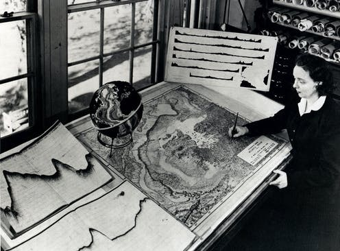 Marie Tharp at work drafting a map at her desk
