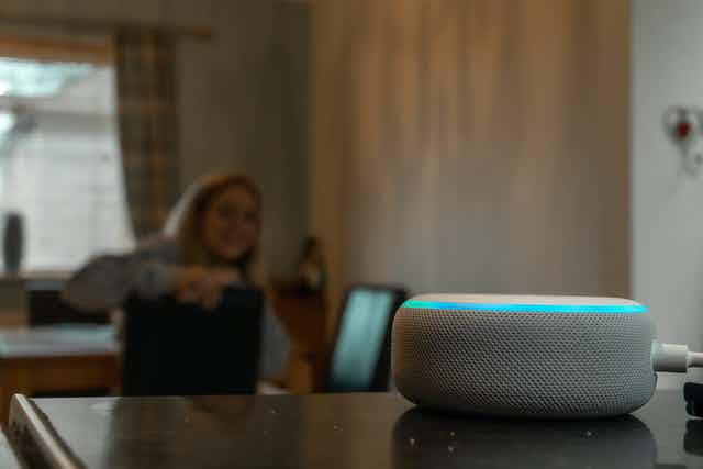 Woman talking to Amazon Alexa artificial intelligence assistant