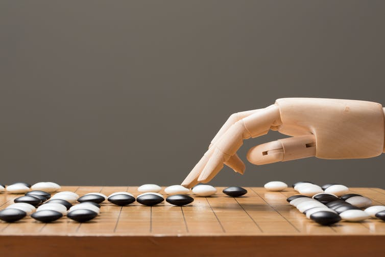 A robot hand playing the ancient Chinese boardgame called Go