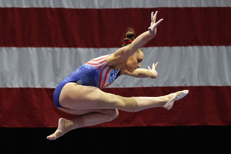 Maggie Nichols leaps.