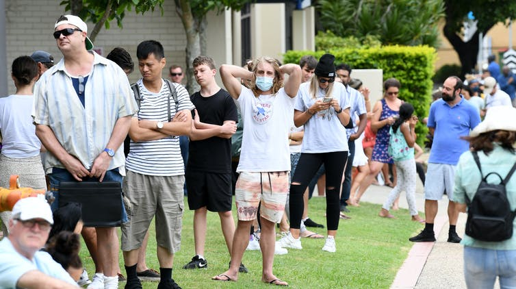 Long queue of Australians line up outside Centrelink office.