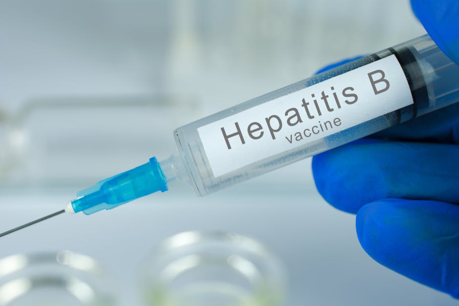 Needle showing the hepatitis B vaccine by a doctor.