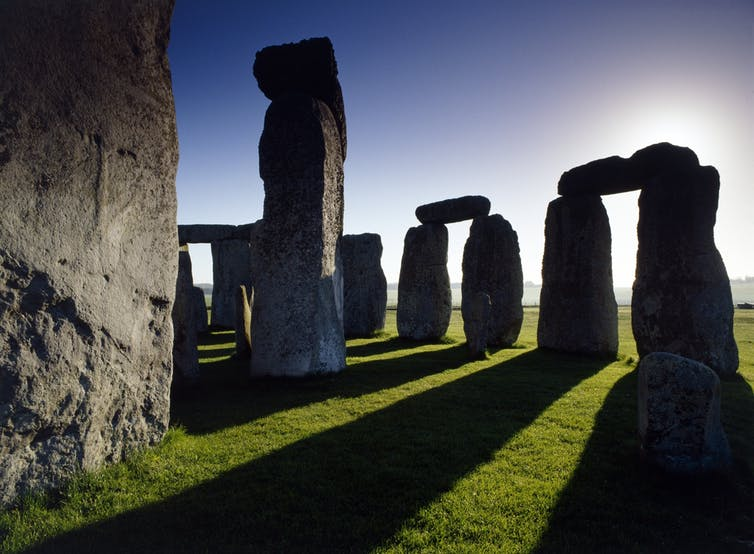 Part of Stonehenge casting shadows.