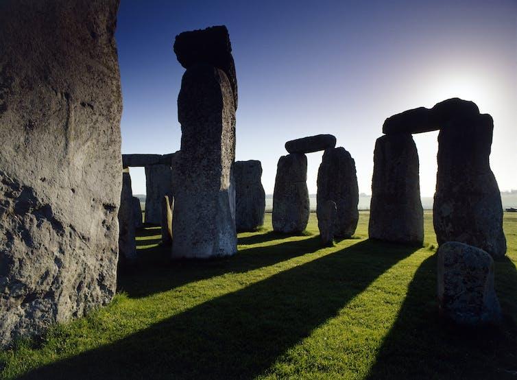 Part of Stonehenge casting shadows.