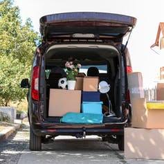 Small van packed with household belongings