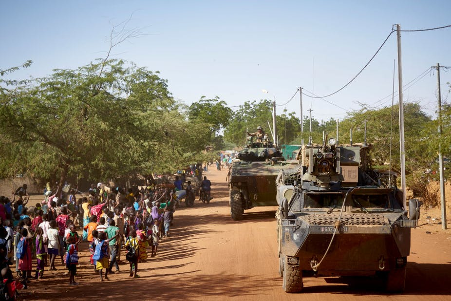 Armoured personnel carriers on the road in Burkina Faso