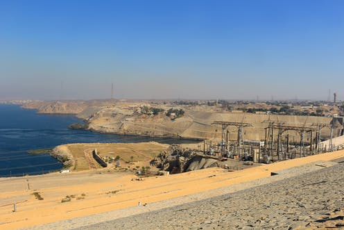 The High Dam in Aswan Egypt showing poles and power lines.