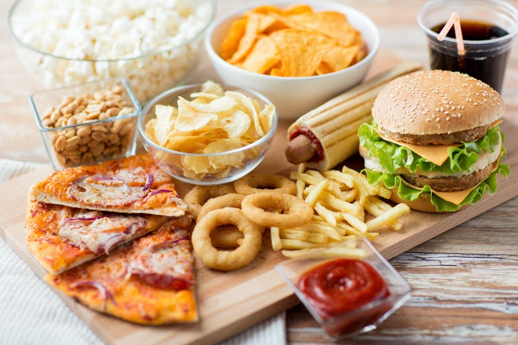 Pizza, a cheeseburger, onion rings, and other unhealthy foods.