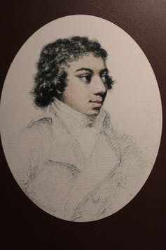 A painting of the Black composer George Bridgetower in an oval frame.