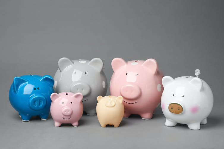Piggy banks of varying colours and sizes.