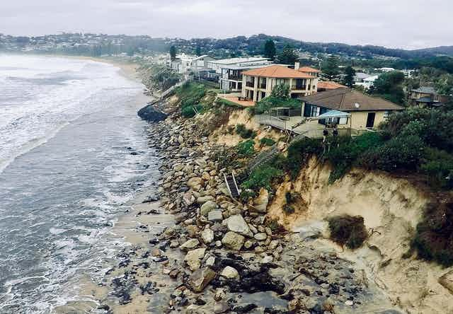 Homes at Wamberal teetering on an eroded cliff face