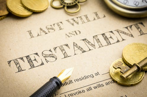 Last will and testament with coins, pen and key