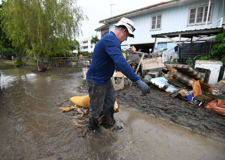 Man cleans up after Townsville flood