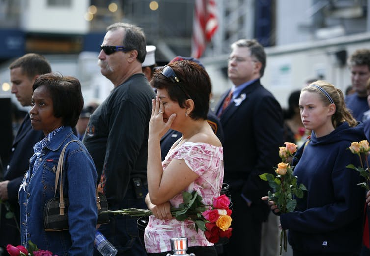 Person crying at memorial service