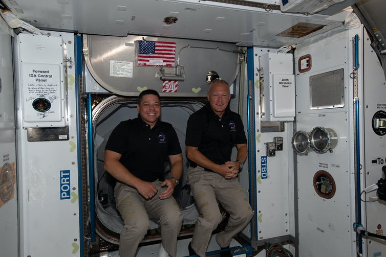 Photo of astronauts Bob and Doug in the ISS.