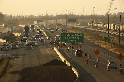 Cars on a highway in Fresno, Calif. under a hazy sky