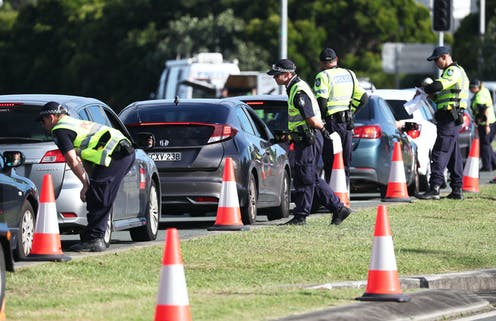 A police checkpoint at the Queensland-NSW border.