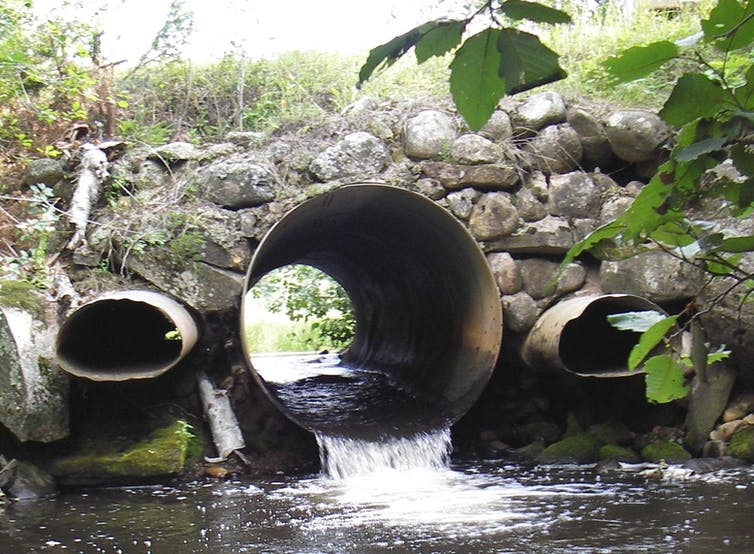 Culverts, big and small, built below roads allow rivers to pass through beneath it.