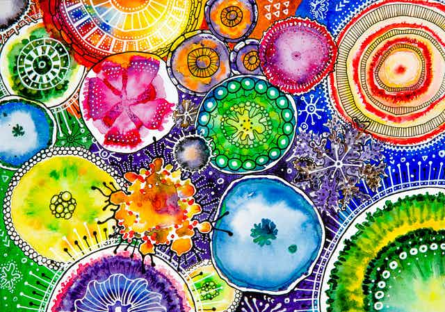 A watercolour depicting multi-coloured microbes.