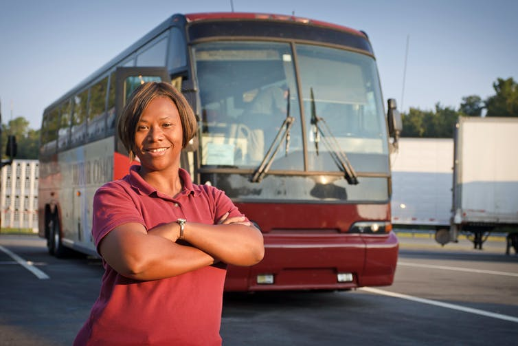 Picture of a female bus driver.