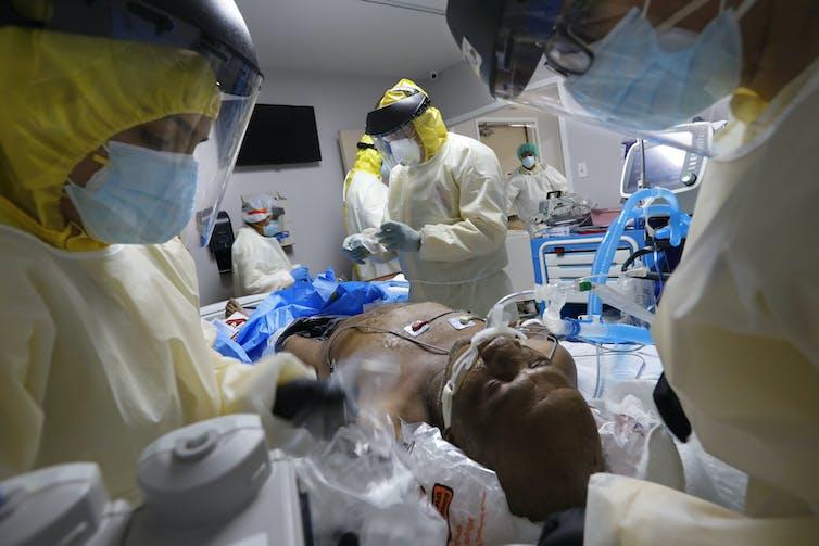 A Houston, Texas, medical team puts a patient on a ventilator.