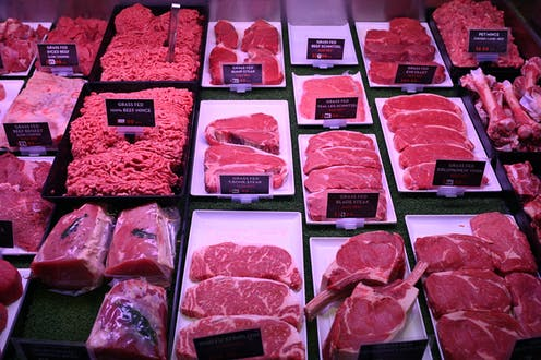 Meat cuts displayed in butcher shop.