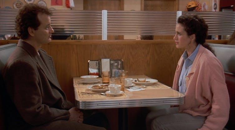Phil and Rita at a diner.