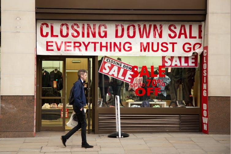Closing down sale sign in a shop window.