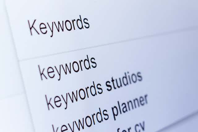 """A search engine bar, with the word """"keywords"""" entered and suggestions below."""
