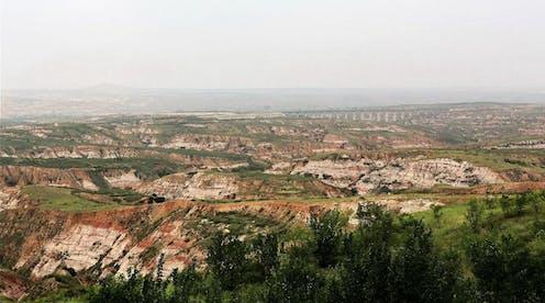 Landscape of eroded rocky hills.