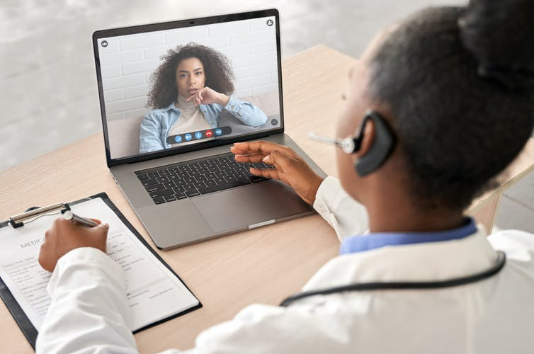 A patient and a doctor doing a consultation via video call