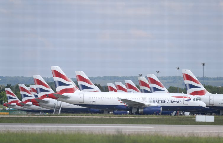 British Airways planes parked on an airport runway