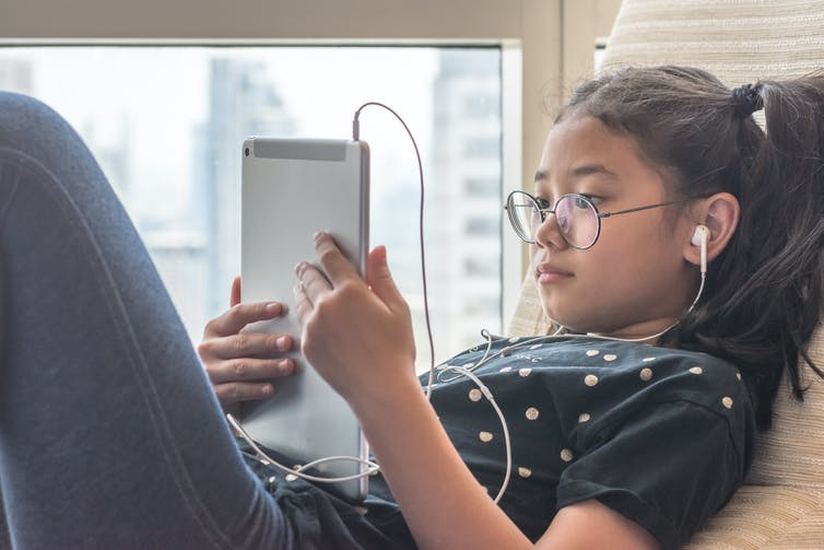 Picture of a child with an ipad.